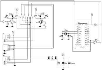 Схема состоит из нескольких частей, микроконтроллер переключает подключенное устройство между портами...